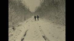Vintage 16mm film, 1948, rural America, car on snow mud road, crazy drive, rural Stock Footage