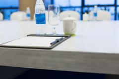 Big oval meeting table and white board in modern meeting room Stock Photos