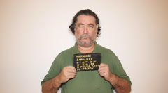 Mug shot mugshot police booking photograph Stock Footage