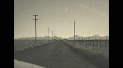 Vintage 16mm film, 1948, driving SW Alberta, Rockies on the horizon - stock footage