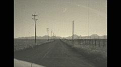 Vintage 16mm film, 1948, driving SW Alberta, Rockies on the horizon - stock footage