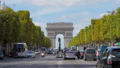 Arc de Triomphe and Champs Elysees traffic pan Stock Footage