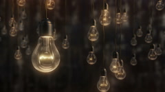 Beautiful edison style light bulbs against black wall background Stock Footage