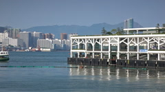 Star Ferry pier and docks to unload and pick up passengers. - stock footage
