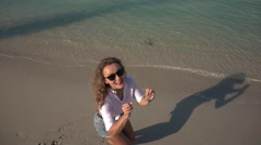 Happy Young Woman Jumping on a Beach. Slow Motion.  - stock footage