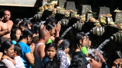 Balinese families come to the sacred springs water temple. Bali, Indonesia Stock Footage
