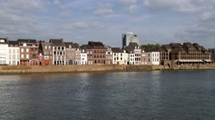 View to the historical buildings at the riverside in Maastricht, Netherlands. Stock Footage