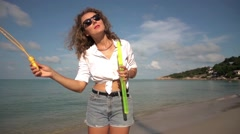 Carefree Woman Dancing with Bubbles on Beach. Slow Motion. 250fps Stock Footage