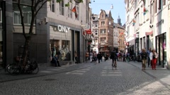 People walk by the street in Maastricht, Netherlands. Stock Footage
