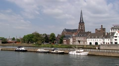 Historical buildings at the riverside of Meuse river in Maastricht, Netherlands. Stock Footage