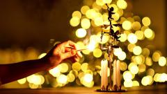closeup woman lighting candles of angel chimes - stock footage