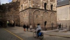 People walk by the street in front of the Saint Servatius church. Stock Footage