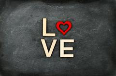 Vintage chalkboard with word LOVE created of wood letters Stock Photos