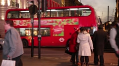Red busses passing by on Piccadilly Circus, London, England Stock Footage