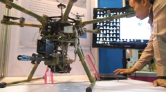Small Drone Hexacopter with Weapon on Military Exhibition Stock Footage