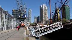 People walk by the riverside at the historical harbor in Rotterdam, Netherlands. Stock Footage