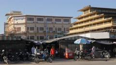 Woman coming from Psar  Nat central market,Battambang,Cambodia - stock footage