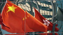 Flags Reflection of Hong Kong and China, time-lapse. Color graded - stock footage