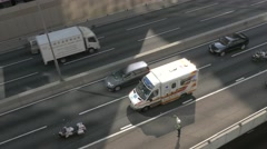 Traffic on Highway with ambulance and policeman. - stock footage