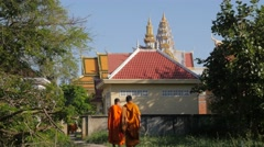 Monks walking towards Wat Bo Knong,Battambang,Cambodia Stock Footage