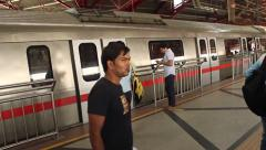 New Delhi Metro stops and passengers get off and on, filmed in high speed - stock footage