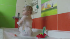 Little girl bathes in a bath with toys Stock Footage