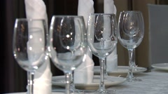 A set of glasses and napkins on the table. Stock Footage