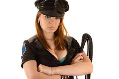 woman in costume policeman with whip - stock photo