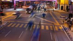 Traffic rush towards on green light, time lapse from above road. Stock Footage