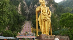 Entrance to Batu Caves with Murugan statue, POV walk away time lapse shot Stock Footage