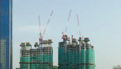 Modern building, twin towers under construction, concrete frame, time lapse Stock Footage