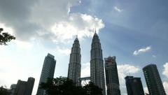 Cumulus clouds in sun light, KLCC Petronas Twin Towers time lapse Stock Footage