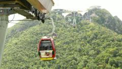 Langkawi gondola lift move away against woody slope, time lapse shot Stock Footage