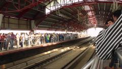Passengers wait for the train to arrive in the New Delhi metro system. Stock Footage