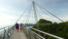Tourist at Langkawi Skybridge, one pylon suspension bridge, time lapse Stock Footage