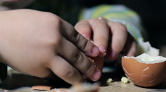 Kid cleans separates egg Stock Footage
