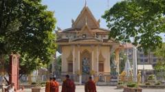 Monks walking towards wat Sanker,Battambang,Cambodia Stock Footage