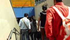 People enter the New Delhi metro system, going down a staircase. Still shot, Stock Footage