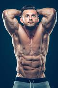 Strong Athletic Man Fitness Model Torso showing six pack abs. isolated on black Stock Photos