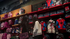 shoppers in Disney flagship store - stock footage