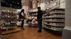 Shoppers in Disney flagship store Stock Footage