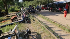 Tourists leaving Bamboo train station on norry,Battambang,Cambodia Stock Footage