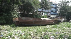 Swinging moored old boat in polluted water of Bangkok Stock Footage