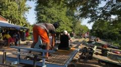 Man starts engine of Bamboo train norry,Battambang,Cambodia Stock Footage