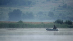 Fisherman on an inflatable boat - stock footage