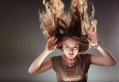 Mysterious enigmatic woman girl with flying hair. - stock photo