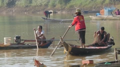Fishermen fishing in Sanker river in canoe,Battambang,Cambodia Stock Footage