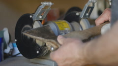 Sharpening hatchet with tool grinder Stock Footage