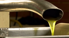 closeup footage of extra virgin olive oil flowing: fresh oil after squeeze  - stock footage