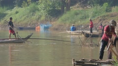 Fisherman throwing net in water,Battambang,Cambodia Stock Footage